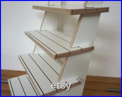 White plywood tiered display with four reversible shelves for 75 product cards or candles soaps sturdy flat pack market and shop stand